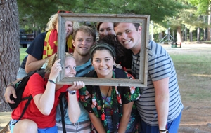 Photo of staffers in a picture frame.